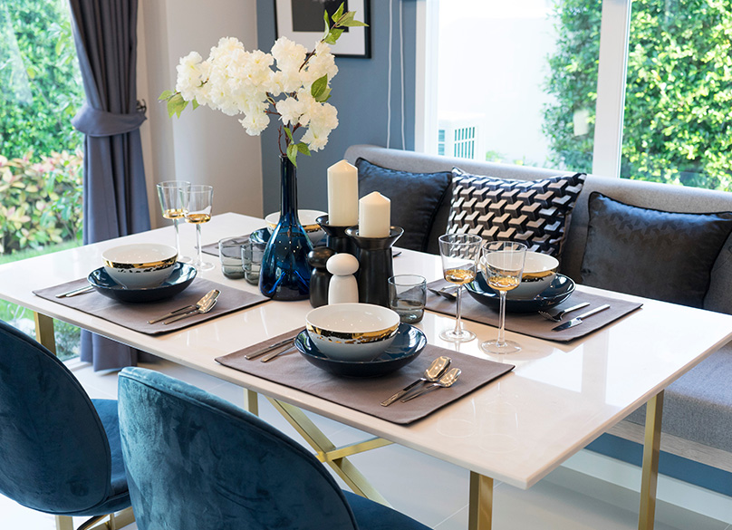 A stylish dining room with window seating