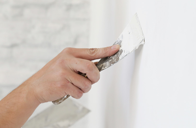 Fill any holes with spackle using a putty knife